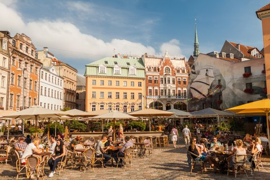 A lively square in the historical Old Town of Riga